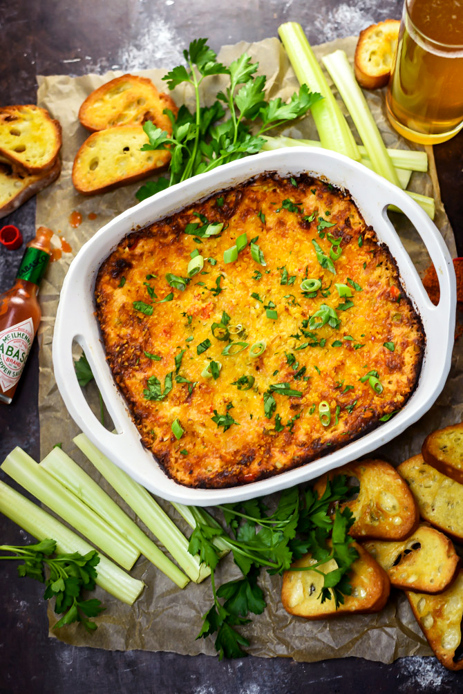 Hot Cajun Crab Dip. This cheesy, decadent dip is full of bold flavors and tender crab! | hostthetoast.com
