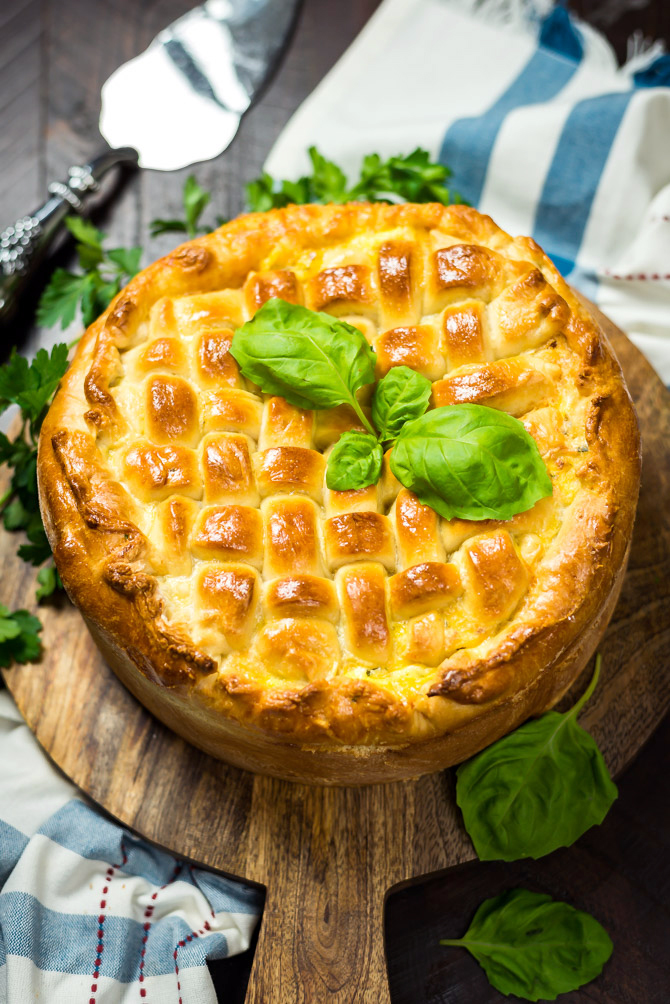 Italian Easter Pie. Also known as Pizza Rustica, Pizza Gaina, or Pizza Chena, this pie is easy to make and loaded with Italian favorites like provolone, mozzarella, ricotta, ham, sausage, pepperoni, and sopressata. | hostthetoast.com