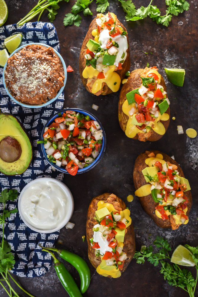 Nacho Baked Potatoes. These fluffy russets are loaded up with refried beans, sour cream, pico de gallo, avocado, and an easy queso cheese sauce. | hostthetoast.com