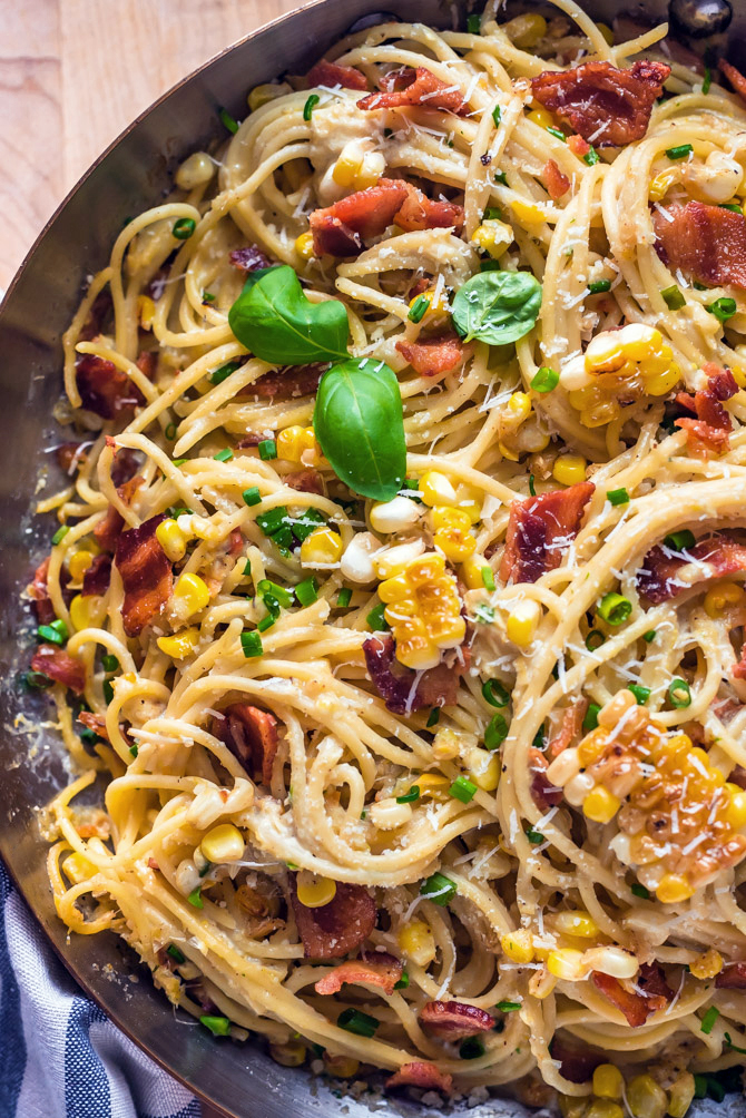 20 Minute Corn Carbonara. This quick and easy pasta dish is filled with fresh corn and bacon, and flavored with a creamy corn-based sauce. No eggs are necessary for this spin on carbonara! | hostthetoast.com