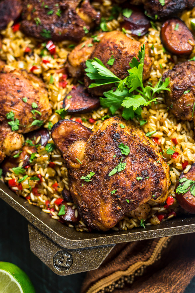 One Pot Cajun Chicken and Rice. This delicious one pot dinner features tender seasoned Cajun chicken, andouille sausage, and flavorful rice, and it takes less than an hour to make from start to finish. | hostthetoast.com