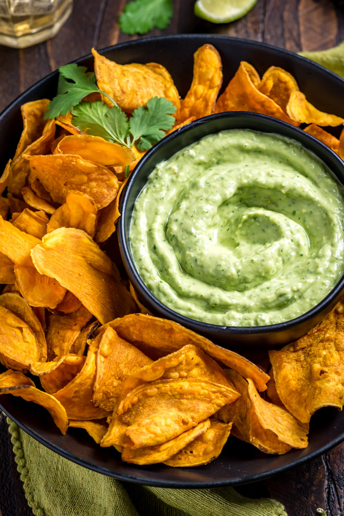 This Dreamy, Creamy Avocado Cilantro Sauce takes just 5 minutes to make and is perfect for serving on tacos, over salads, with sweet potatoes, or simply with a side of chips for dipping. Let's be honest, you're going to eat it on everything. | hostthetoast.com