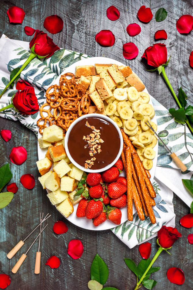 The Easiest Boozy Chocolate Hazelnut Fondue. All you need for this recipe is 5 ingredients and a microwave. It doesn't get easier than that for date night! | hostthetoast.com