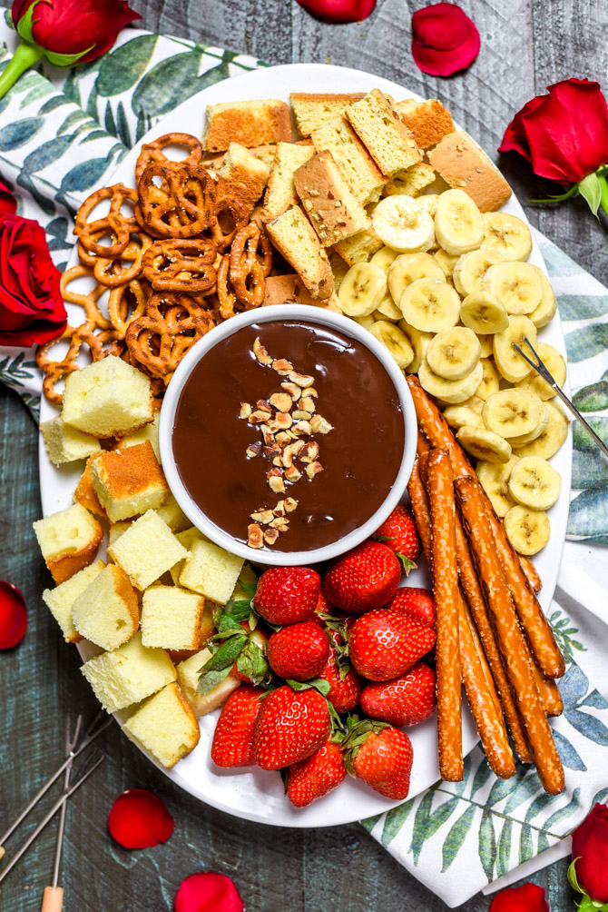 The Easiest Boozy Chocolate Hazelnut Fondue. All you need for this recipe is 5 ingredients and a microwave. It doesn't get easier than that for date night!   hostthetoast.com