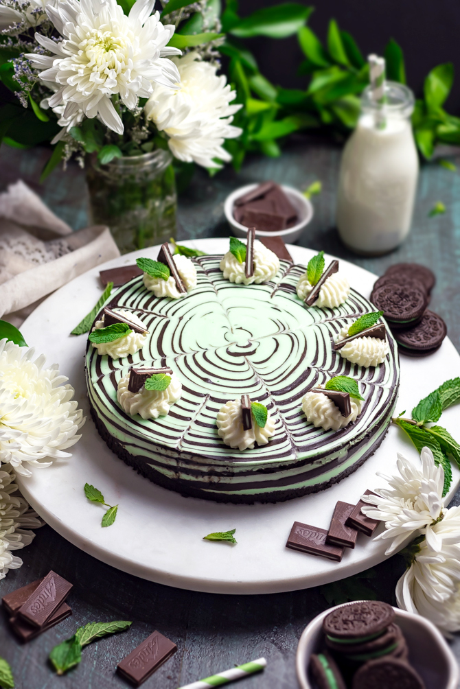 This No-Bake Mint Chocolate Zebra Cheesecake is just as delicious as it is hypnotically stunning. Be warned: It's rich, chocolaty, spiked with plenty of mint, silky smooth, and a total ruiner of self-control. | hostthetoast.com