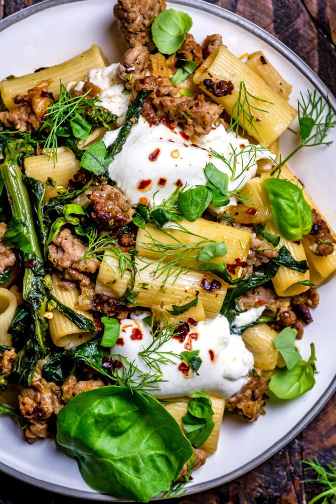 This quick One Pot Lemony Pasta with Sausage, Broccoli Rabe, and Burrata is absolutely loaded with bright and comforting flavors. It takes just 40 minutes to make and is the perfect easy date night-- or weeknight-- dinner. | hostthetoast.com