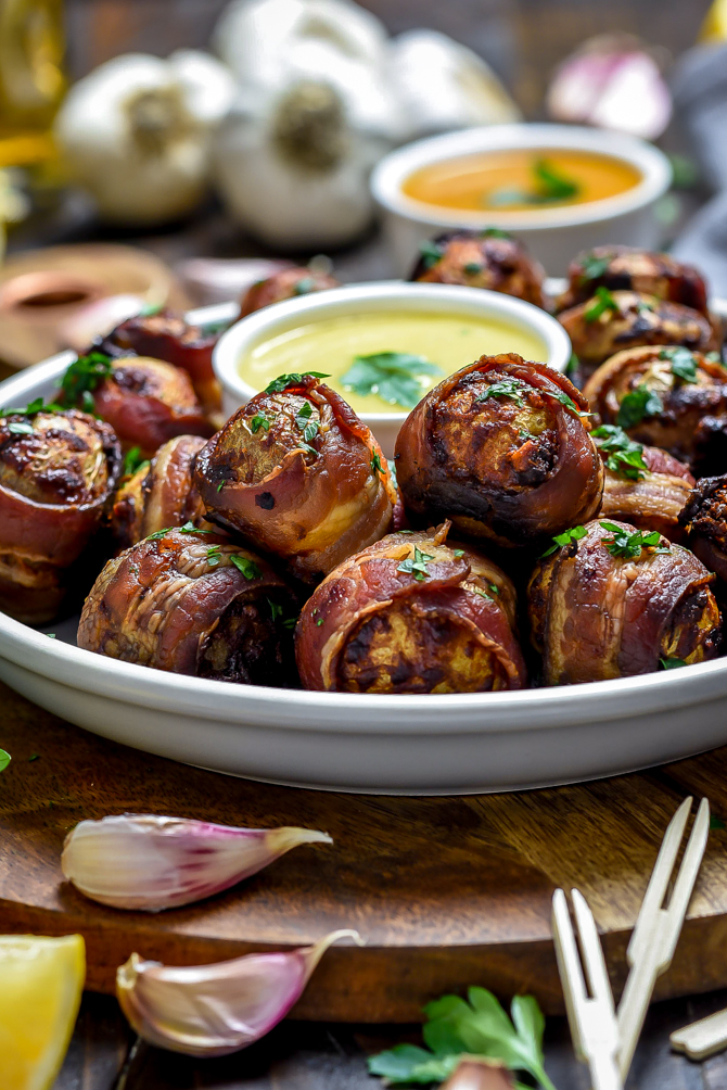 Tender and fluffy on the inside with crisp bacon and a smoky seasoning mix on the outside, Smoky Bacon-Wrapped Baby Potatoes as easy to make as they are to devour. While this recipe technically feeds six, you'll find these addictive one-bite-wonders are best-served in bulk. | hostthetoast.com