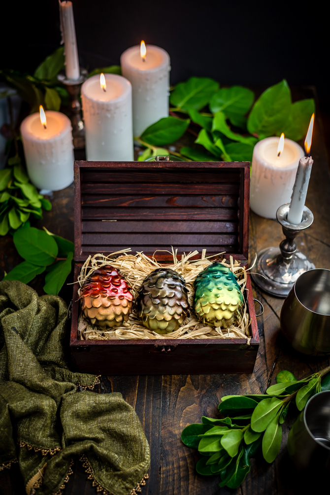 "Easter is coming! There's no better way to celebrate the holiday and the return of Game of Thrones than by making your own Chocolate Peanut Butter Dragon Eggs at home. This recipe includes a Reese's-style peanut butter filling, crunchy sliced almond ""scales"", and a smooth chocolate coating. 