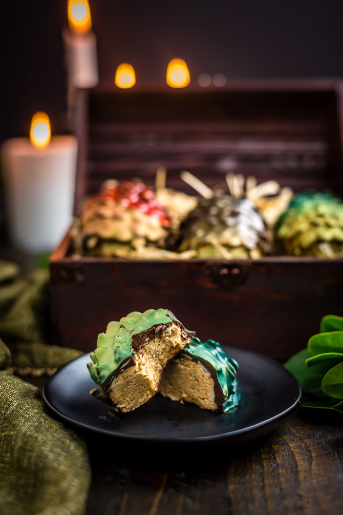 """Easter is coming! There's no better way to celebrate the holiday and the return of Game of Thrones than by making your own Chocolate Peanut Butter Dragon Eggs at home. This recipe includes a Reese's-style peanut butter filling, crunchy sliced almond """"scales"""", and a smooth chocolate coating.   hostthetoast.com"""