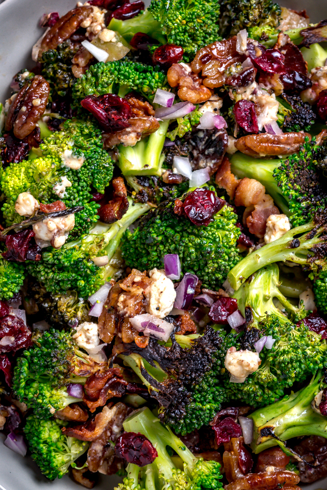 Seared (but still crisp) broccoli forms the flavorful base of this Charred Broccoli Salad with Hot Honey Dressing. With toasted pecans, sharp red onion, crisp bacon, tangy goat cheese, dried cranberries, and a sweet-and-slightly-spicy homemade hot honey dressing, this side dish has a little bit of everything for your cookout, dinner party, or lunch box. | hostthetoast.com