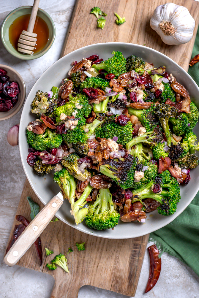 Seared (but still crisp) broccoli forms the flavorful base of this Charred Broccoli Salad with Hot Honey Dressing. With toasted pecans, sharp red onion, crisp bacon, tangy goat cheese, dried cranberries, and a sweet-and-slightly-spicyhomemade hot honey dressing, this side dish has a little bit of everything for your cookout, dinner party, or lunch box.| hostthetoast.com