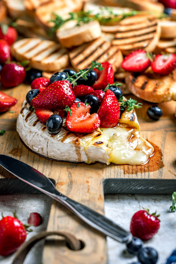 Ready to serve in a few simple steps, Grilled Camembert with Balsamic Macerated Berries is a foolproof dish that will have you seeing stars (and stripes.) | hostthetoast.com