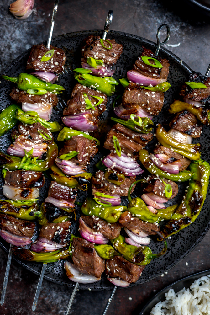 There's more to these Asian Steak and Shishito Skewers than meets the eye. The sweet and garlicky marinated steak will be love at first bite, while the rare spicy surprise of a hot shishito keeps you coming back for more.   hostthetoast.com