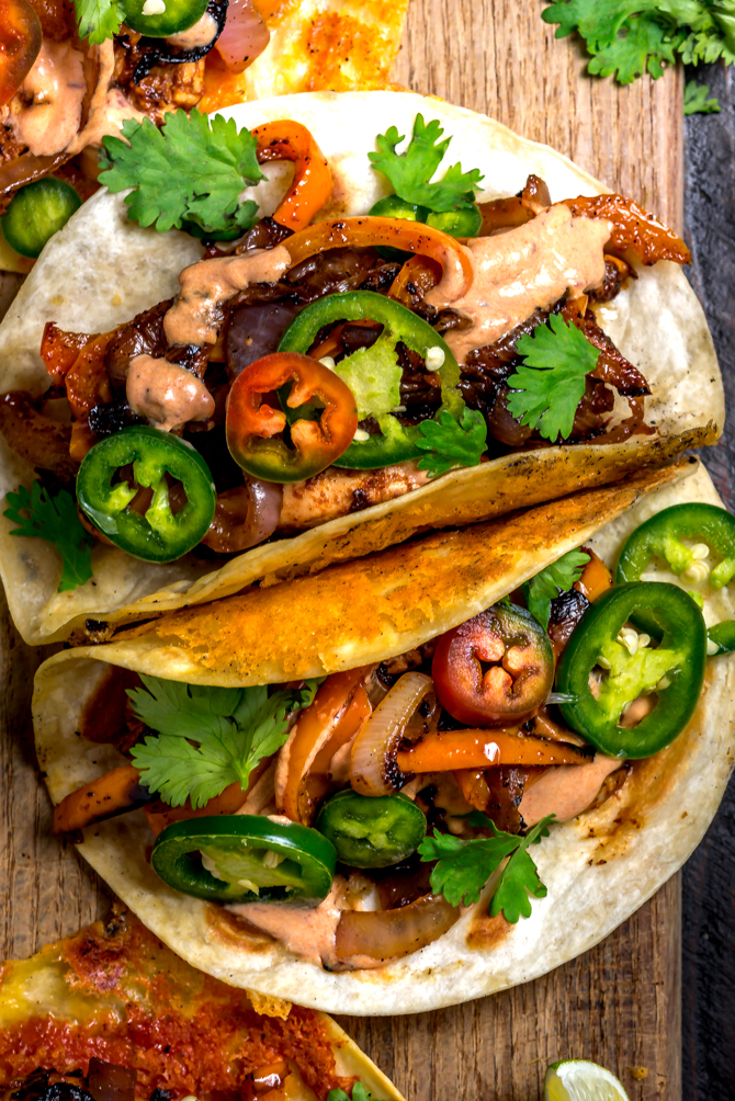 With classic fajita ingredients piled high in crispy cheddar-adorned tortillas and finished with a 3-ingredient chipotle crema, this recipe is bound to be your new Tex-Mex favorite. Crispy Cheddar Chipotle Chicken Fajitas make for an easy, flavor-packed, and picky-eater-approved weeknight dinner. | hostthetoast.com