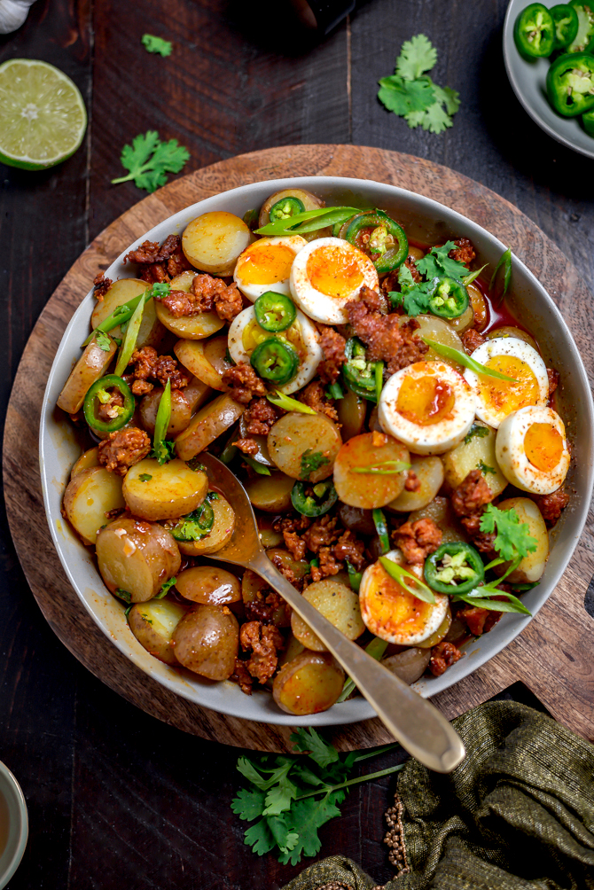 With a whisper of smoke and spice, Warm Chorizo Potato Salad is a Mexican-inspired spin on the German classic. Served with soft-boiled eggs and a chorizo vinaigrette, this mayo-free mash-up is best served warm.  | hostthetoast.com