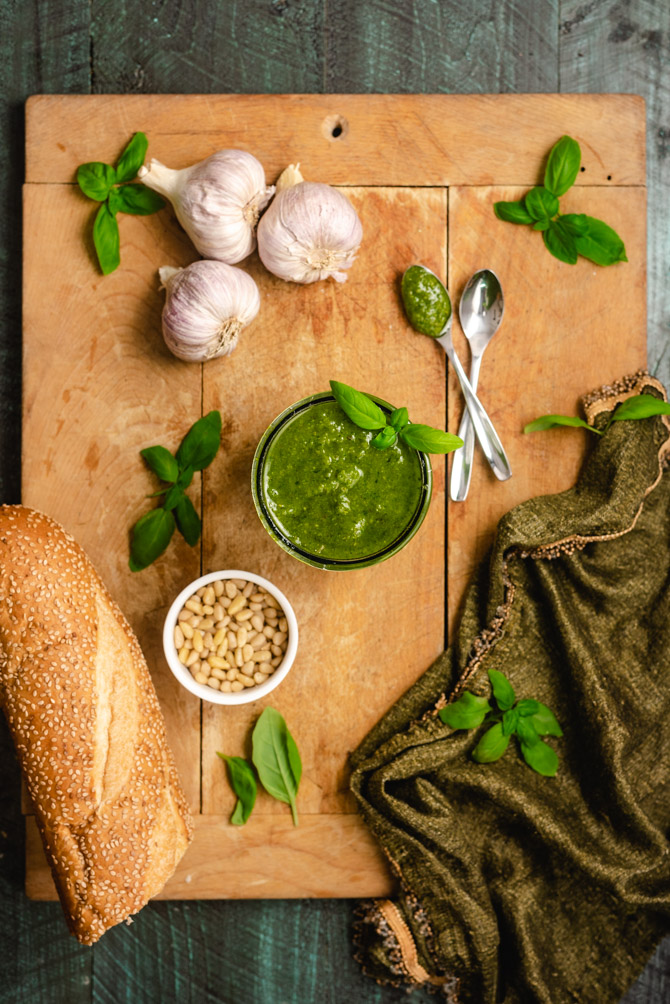 "Classic, homemade pesto can't be beat, so ditch the store-bought stuff and whip up a batch right in your kitchen. All you need is a few simple ingredients and you'll be making this flavorful, basil-packed summer staple in no time. (And by ""no time"", I mean 5 minutes or less!)"