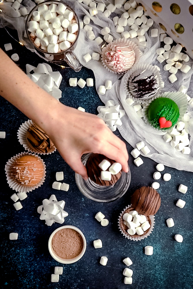 Learn how to make Hot Cocoa Bombs and DIY all of your Christmas gifts this holiday season. These hot cocoa mix and marshmallow stuffed confections will have your friends and family oohing and ahhing as they melt away in warm milk to create the perfect cup of hot chocolate.