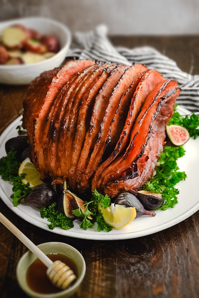 Slow Cooker Ham is the ultimate holiday centerpiece. This recipe gives you amazingly flavorful, juicy ham with caramelized, honey-glazed edges-- all without hogging up your oven space.