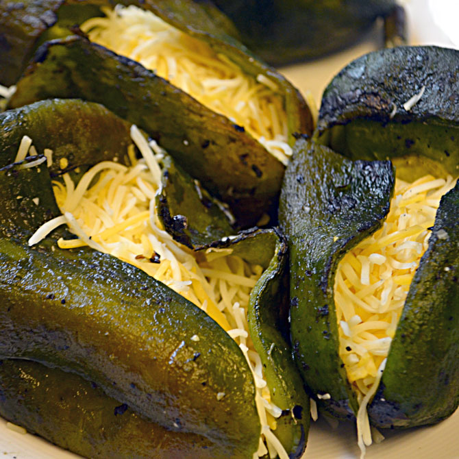 Putting cheese in the chile rellenos