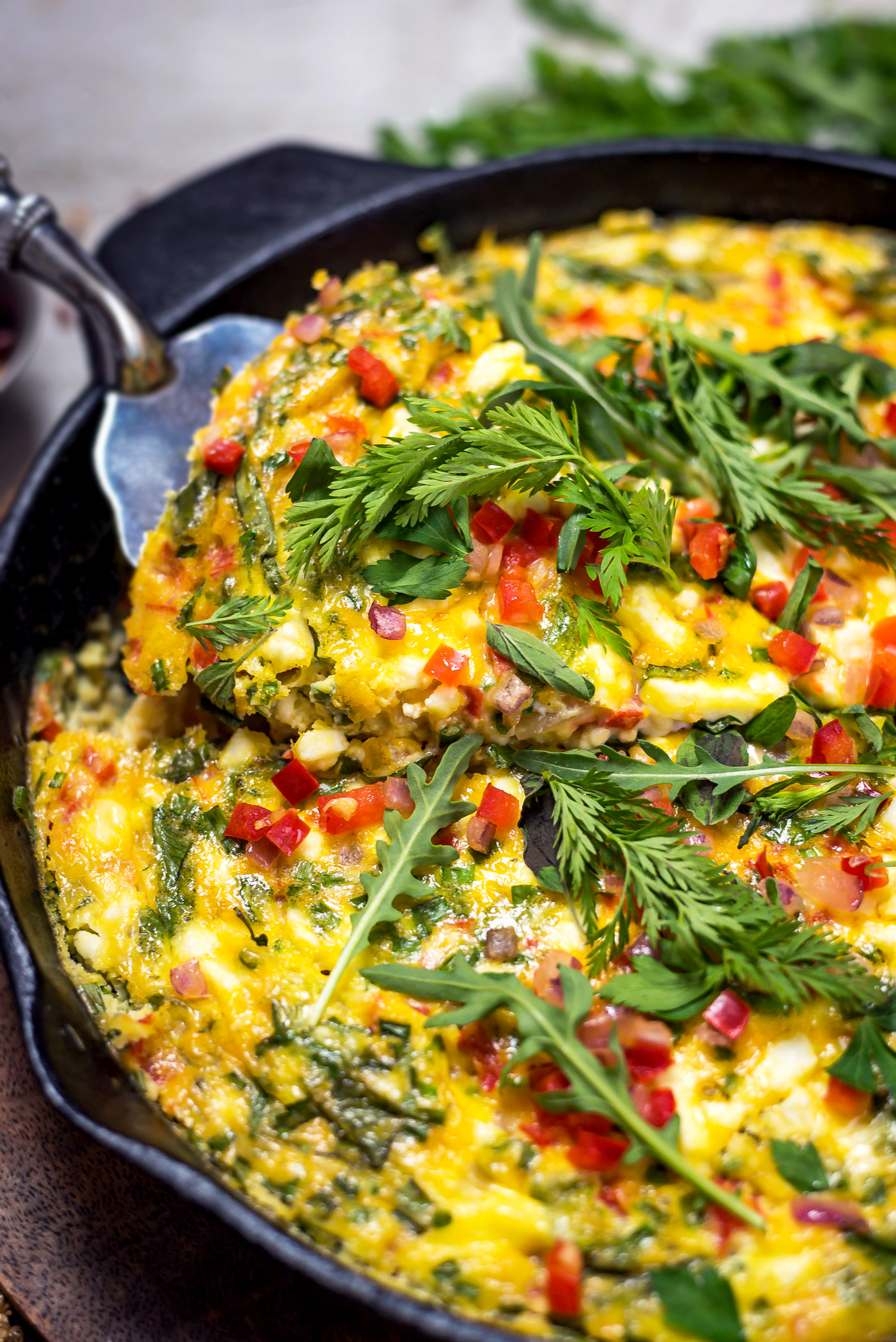 Feta, Red Pepper, and Herb Frittata. This eggy recipe makes a wonderful and easy breakfast-in-bed meal for Mother's Day, a great addition to Easter brunch, and an impressive entertaining option that requires only a few minutes to throw together! | hostthetoast.com