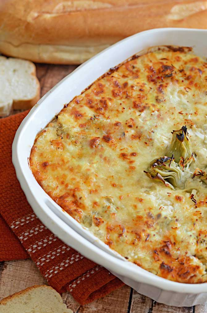 Cheesy Crab and Artichoke Dip. SWOON. | hostthetoast.com