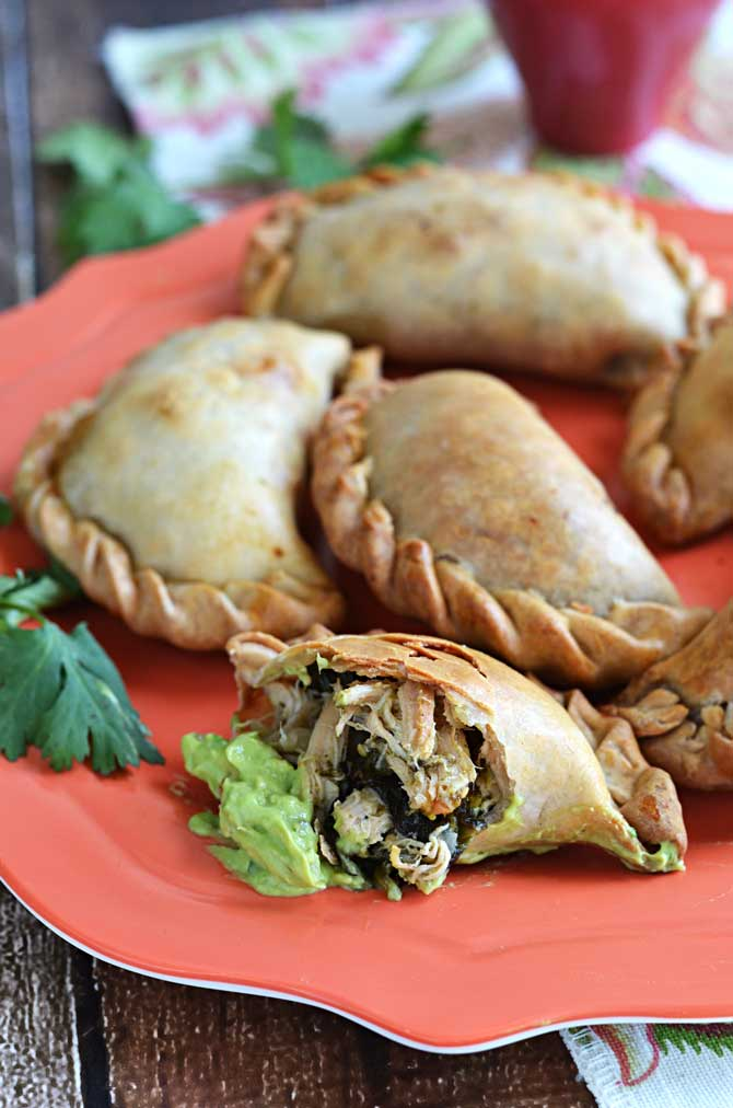 Chicken, Spinach, and Poblano Empanadas with Avocado-Jalapeno Dip.  These make great appetizers, or make them ahead of time for on-the-go meals. | hostthetoast.com