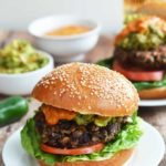 Black Bean Burgers with Chipotle Lime Tahini and Crunchy Guacamole