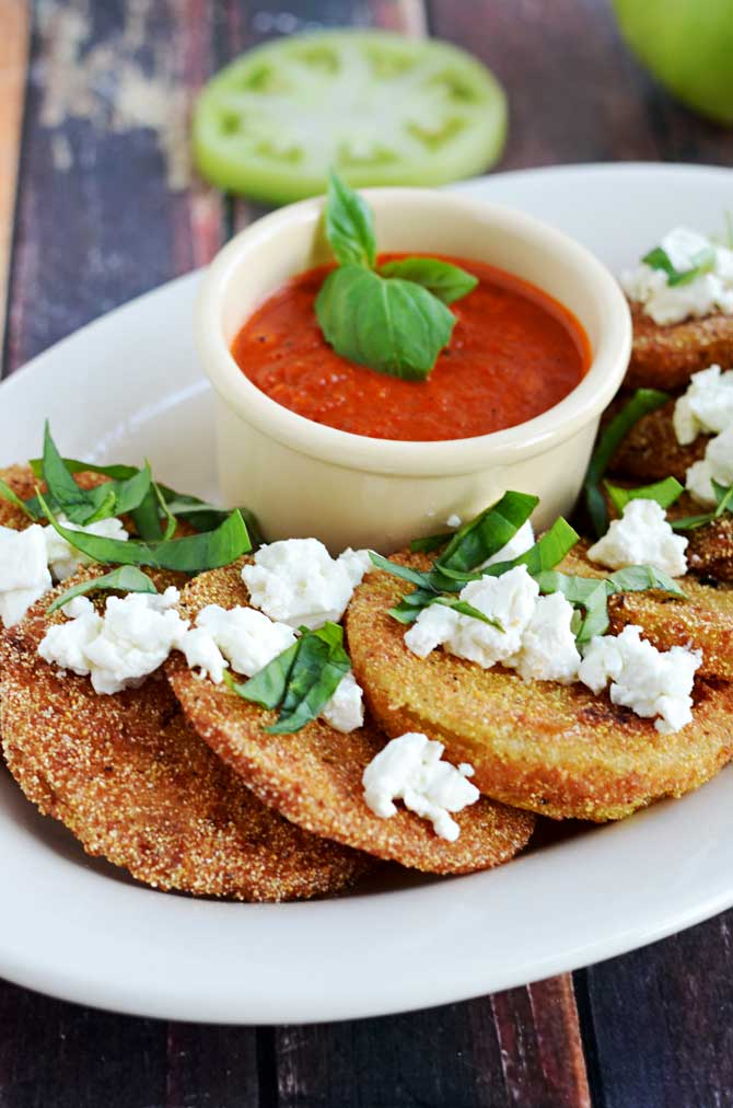 Fried Green Tomatoes with Goat Cheese and Roasted Red Pepper Vinaigrette.  This Southern-meets-Italian appetizer is bound to be a late-summer favorite.  I crave it all year long! | hostthetoast.com