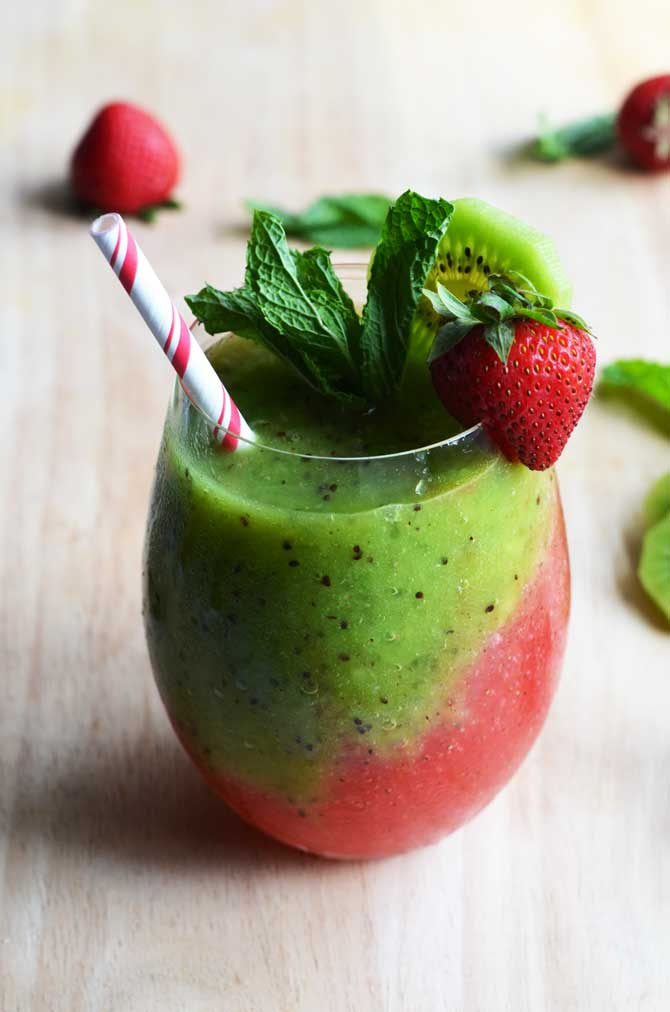 Strawberry-Kiwi Frozen Mojito. Fresh fruit, mint, rum, simple syrup, and ice makes this the PERFECT summer drink. It tastes even better than it looks! | hostthetoast.com