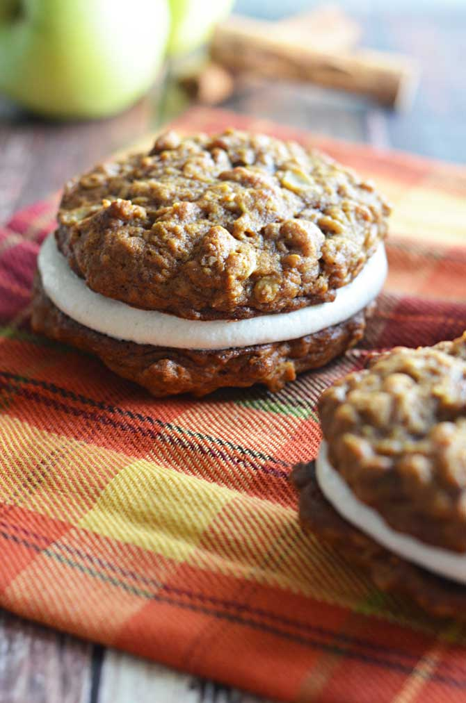 Pumpkin & Apple Cider Oatmeal Creme Pies.  The pumpkin oatmeal cookies will make you swoon by themselves.  With the apple cider creme?  Oh, words cannot express that level of fall deliciousness. | hostthetoast.com