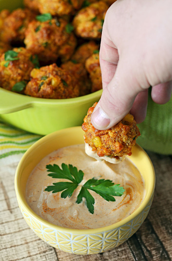 Cheesy Chorizo Cornbread Balls with Chipotle Dipping Sauce.  The upgraded version of Sausage Balls-- so good for parties.  Must have for the Super Bowl. | hostthetoast.com