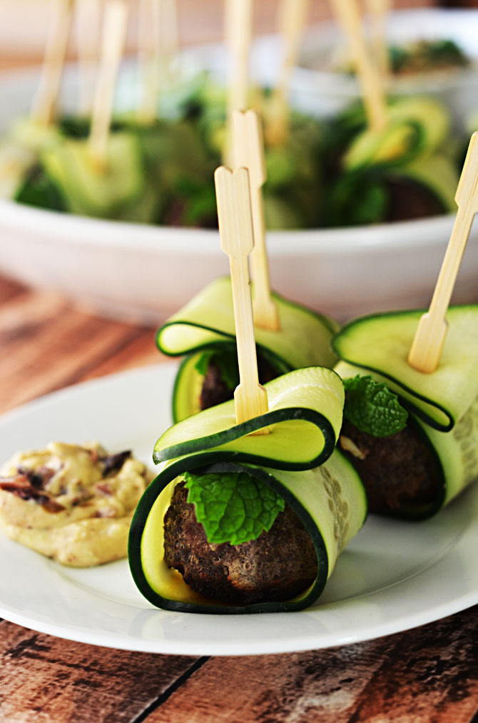 Cucumber Wrapped, Feta Stuffed Meatballs.  These Mediterranean-inspired meatballs are a HIT as an appetizer, and they're healthier than the usual options!  Served with hummus or tzatziki, they are perfect for parties!