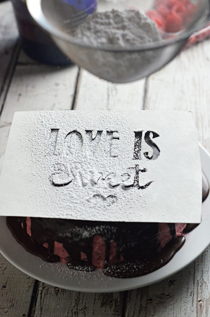 Sugar Stenciled Raspberry Dark Chocolate Cake.  Ultra moist dark chocolate cake, raspberry frosting, and simple dark chocolate ganache make a tasty cake that's topped with a sweet powdered sugar message. Great for a birthday or Valentine's Day! | hostthetoast.com