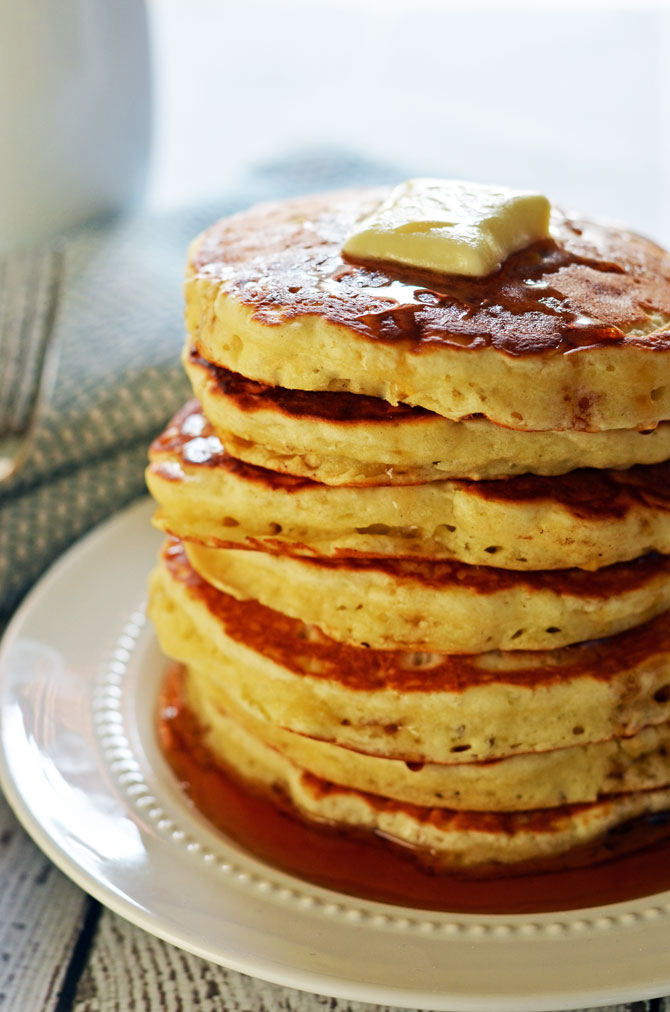 Fluffy Old Fashioned Pancakes.  These pancakes are almost as easy as bisquick, and don't require buttermilk (but you still get that signature flavor!)  Check out the recipe to find out how to make the most perfect pancakes in just minutes. | hostthetoast.com