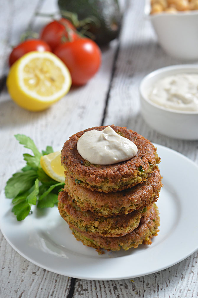 Avocado, Chickpea, and Feta Fritters.  Creamy, buttery, almost nutty patties, livened up with spices and tangy feta cheese.  These are great on their own or in pitas with tahini sauce! | hostthetoast.com