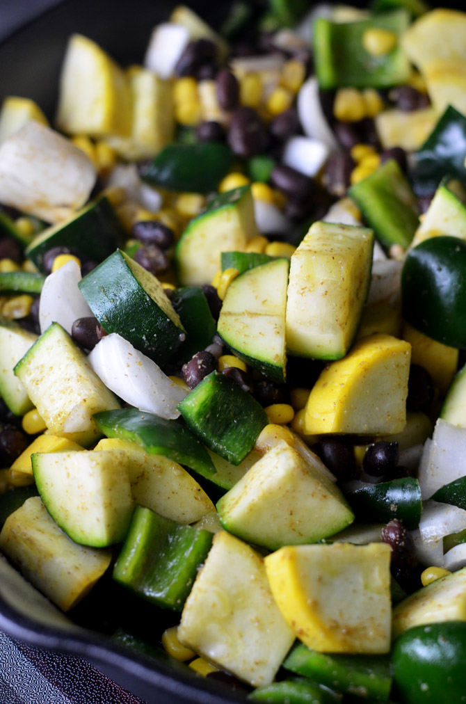Easy Vegetable Enchilada Skillet. Summer squash, zucchini, poblano peppers, onions, corn, and black beans come together in this seriously delicious Mexican spin-off. Not to mention, it only takes ~30 mins to put together! It's a must-make. | hostthetoast.com