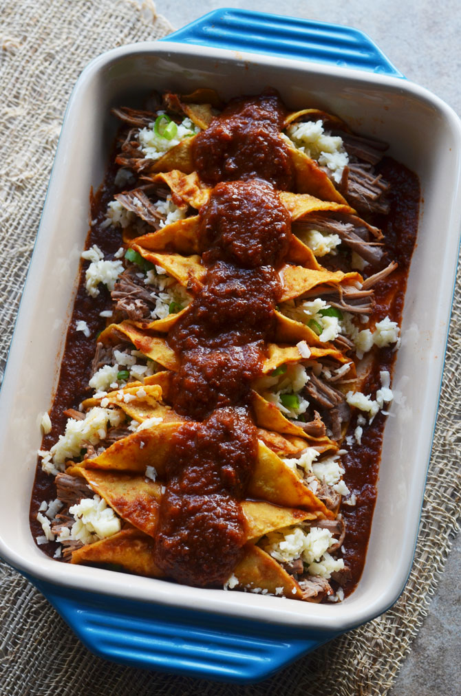 Slow Cooker Honey Chipotle Stout Enchiladas. The beef and sauce is cooked in the slow cooker for ultra tender, flavor packed enchiladas that will rock your tastebuds. | hostthetoast.com