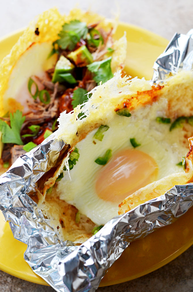 Frico Egg Breakfast Tacos. Put your leftovers in a shell made of crispy cheese and eggs! | hostthetoast.com