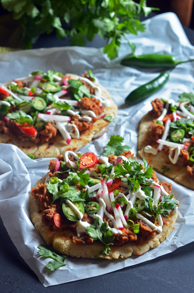 Pupusa Pizzas! These Salvadoran style flatbreads are made of cheese-stuffed, ultra-thick corn tortillas, and topped with chorizo refried beans! It's easier to make than you'd think! | hostthetoast.com