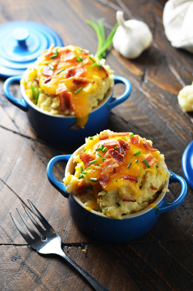 Loaded Mashed Cauliflower. Cheesy, creamy, mashed cauliflower with plenty of bacon that's low on calories. Perfect for a low carb alternative to mashed potatoes! | hostthetoast.com