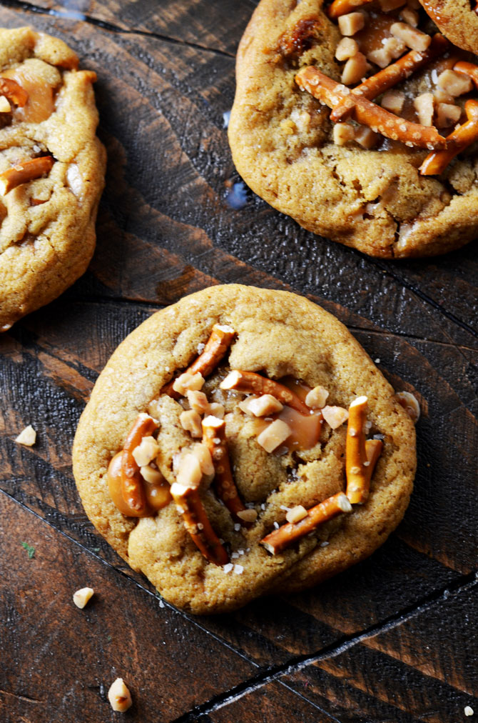 Salted Caramel Crunch Cookies. These brown butter based cookies are loaded up with caramel, toffee pieces, and salty pretzels to make an irresistible cookie that's perfect for the holidays! | hostthetoast.com