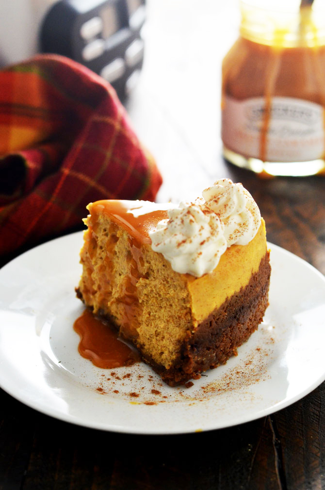 Slow Cooker Pumpkin Cheesecake. This drool-worthy fall dessert is cooked in the crock pot, which keeps it moist and creamy. Best of all, it takes up no room in the oven, so you can make it while you prepare your favorite comfort foods for date night or Thanksgiving dinner! | hostthetoast.com