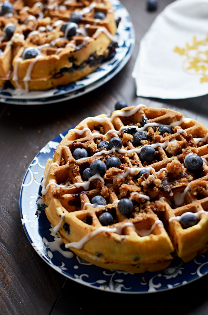 Blueberry Muffin Waffles with Cinnamon Streusel and Vanilla Glaze. These fresh blueberry loaded waffles are dense and taste just like bakery muffins but with a crisp, lightly toasted exterior. Make them a sweet treat with streusel and vanilla glaze, or simply serve them with a pat of butter. Great for a breakfast or brunch get-together.   hostthetoast.com