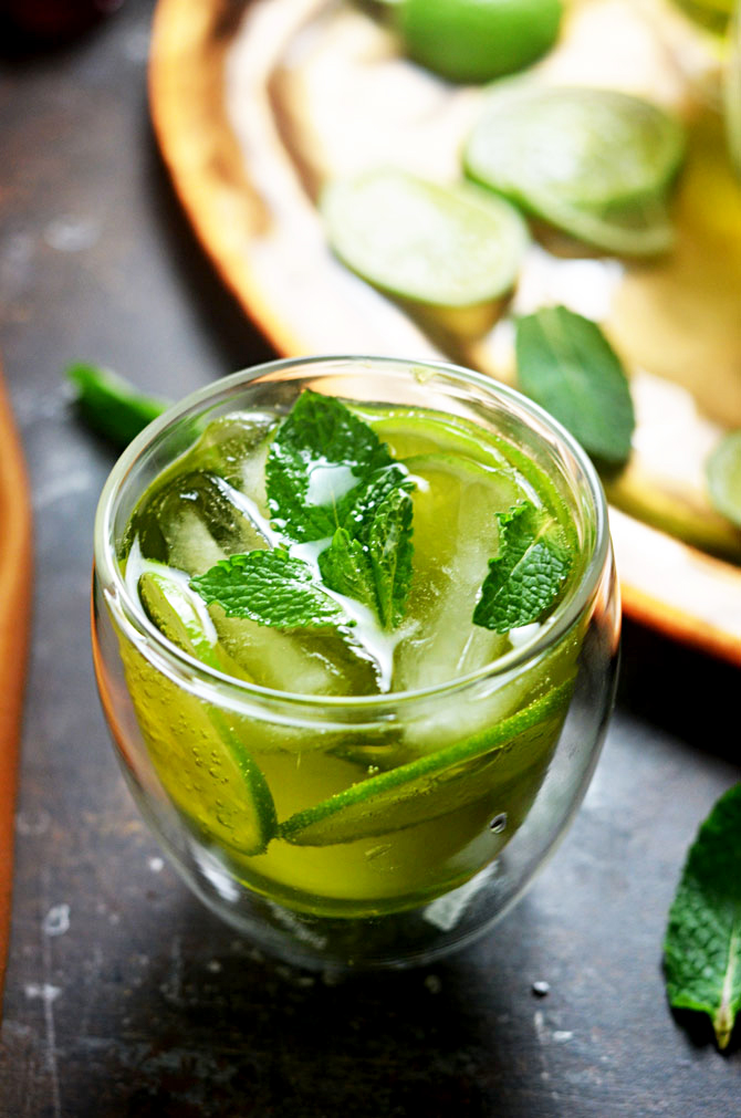 Melon Whiskey Ginger. This simple cocktail features midori melon liqueur, Jameson whiskey, ginger ale, lime wheels, and fresh mint. It's perfect for St. Patrick's Day, and delicious enough to become a go-to summer drink as well!   hostthetoast.com
