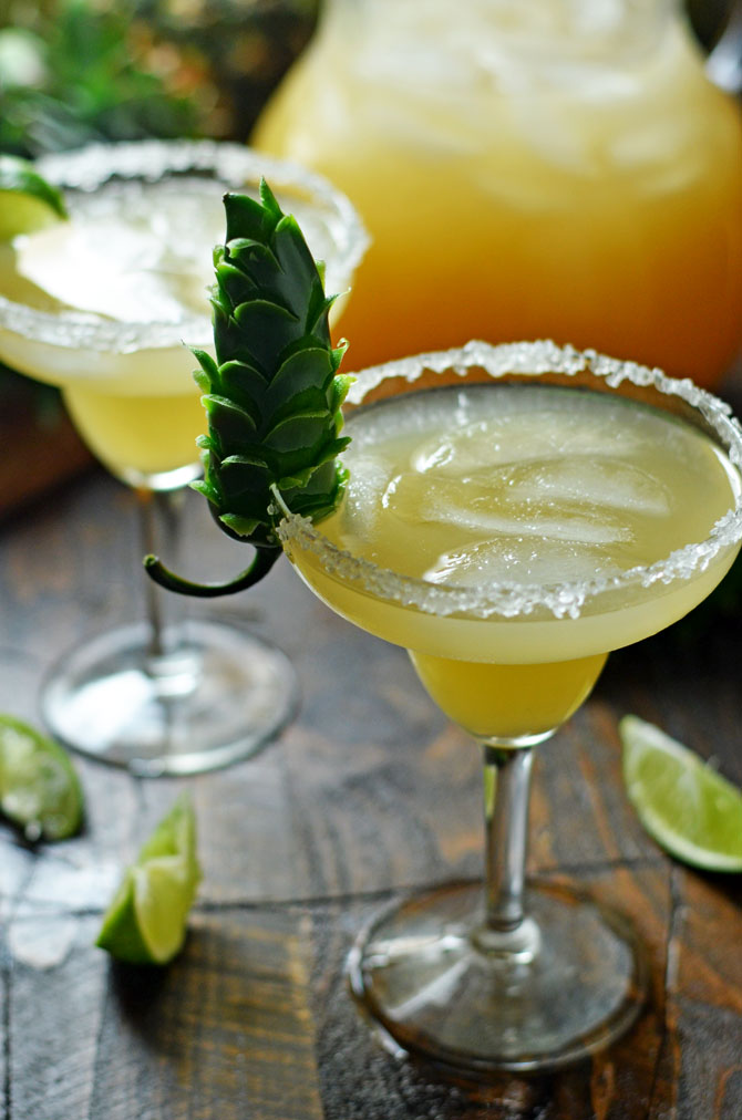 Caramelized Pineapple and Jalapeño Margaritas. Sweet, spicy, and citrus flavors come together in this refreshing cocktail. | hostthetoast.com