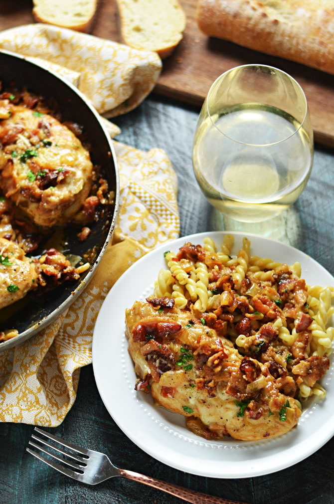 Smothered Bacon Asiago Wine Chicken. This cheesy, creamy, easy to make chicken dish is going to become a household favorite, and takes less than an hour to prepare. | hostthetoast.com