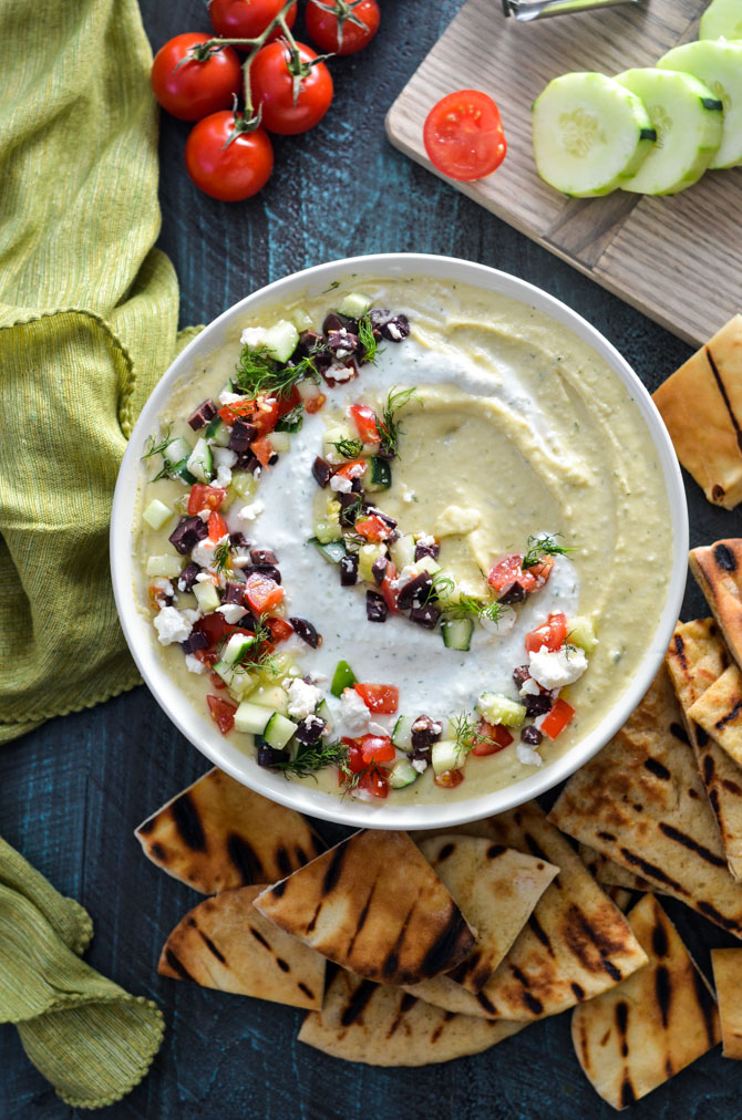 Whipped Feta Tzatziki Hummus. This creamy, cool dip swaps out tahini for feta cheese and a dip of Greek yogurt, cucumber, dill, and lemon. It's bright, summery, and perfect for a picnic! | hostthetoast.com