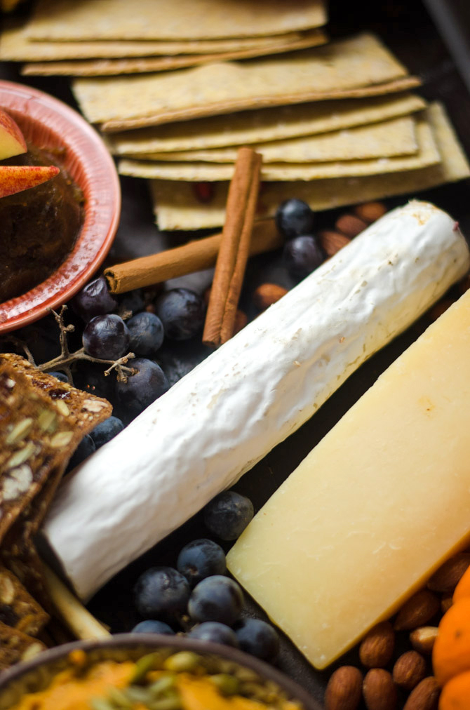 How To Make The Ultimate Autumn Harvest Cheese Board. Tips on selecting the best ingredients, plus recipes for Smoky Chipotle Pumpkin Hummus, Candied Bacon, and Bourbon Apple Butter! This is how you REALLY do Thanksgiving.   hostthetoast.com