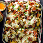 Loaded Pizza Nachos with Creamy Garlic White Sauce