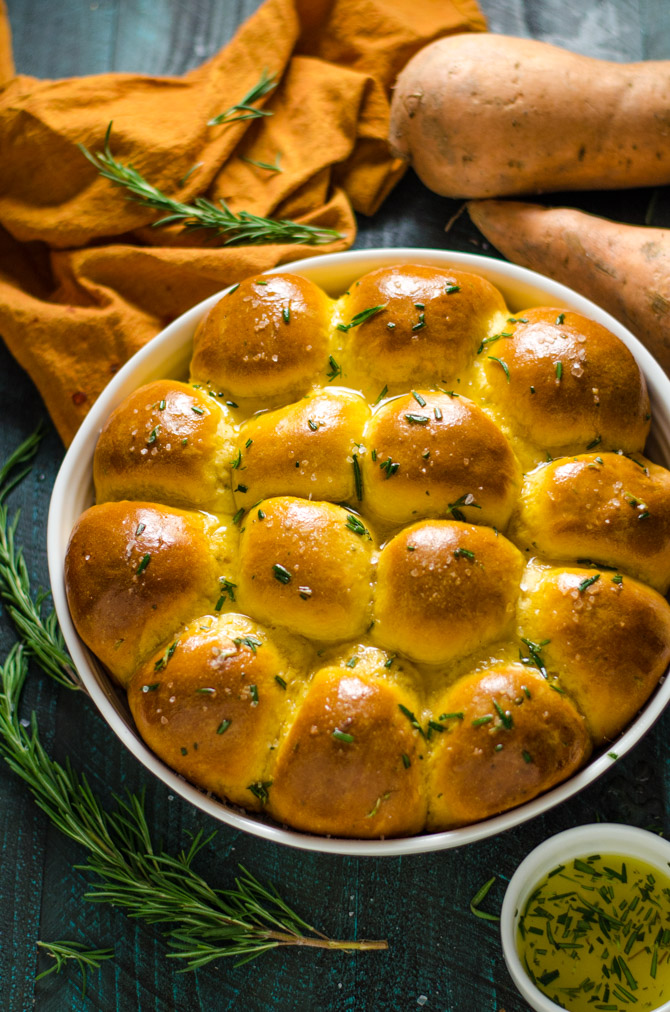 Make-Ahead Rosemary Sweet Potato Rolls. These fluffy, flavorful rolls are not only fool-proof, but they're also easy to make in advance (in several different ways, because who doesn't love options?). Your holiday dinner guests are going to love them. | hostthetoast.com